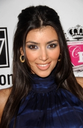 Kim Kardashian With Short Center Part And Half Up/Half Down