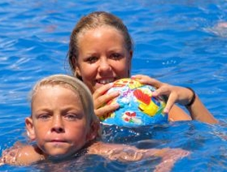 Image of summertime fun at the pool - Courtesy of Haap Media, Inc., - All Rights Reserved