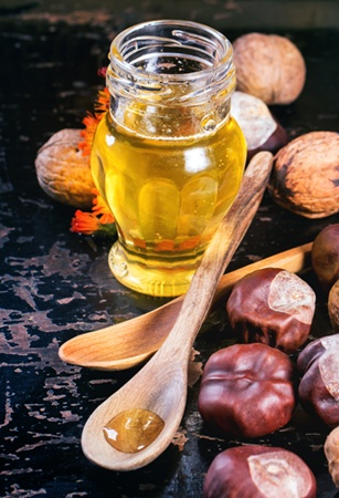 At-Home Hair Care Solutions To Try For Shiny, Fatter And Brass Free Strands -Glass jar of honey nuts - Hairboutique.com