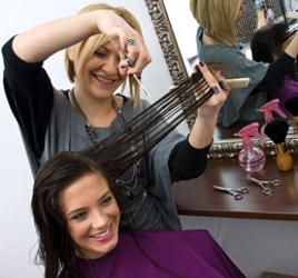 Hairstylist Cutting Hair - Courtesy Empire Beauty School - All Rights Reserved