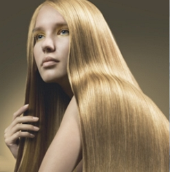 Long Shiny And Detangled Hair - Image Courtesy Of Goldwell