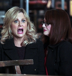 Amy Poehler On Parks and Recreation With Soft Layered Winged Hairstyle