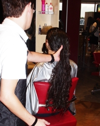 Detangling Newly Shampooed Hair - Image Courtesy Of HairBoutique.com