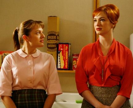Mad Men Season 1, Episode 9 -  Characters/Actors:Peggy Olson (Elisabeth Moss) and Joan Holloway (Christina Hendricks) Photo Credit: Carin Baer/AMC