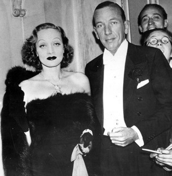 Pictured: Noel Coward with Marlene Dietrich, 1937. Credit: Courtesy of Photofest