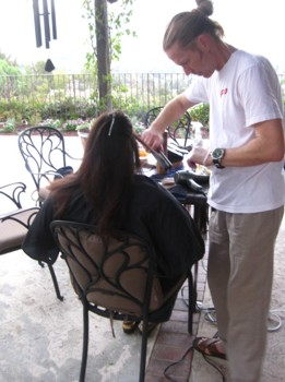 Robert Hallowell Doing Hair On The Patio Of His Home Weaing Famous Man Bun - Photo by Karen Marie Shelton - Hairboutique.com All Rights Reserved