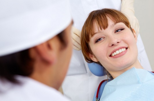 Image of Smiling Dental Patient - GraphicStock.com - All Rights Reserved