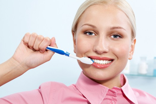 Brushing White Teeth - GraphicStock - All Rights Reserved