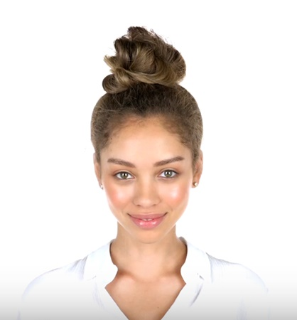 Blog about How To Create An Easy Top Knot Hair Style for Curly Hair