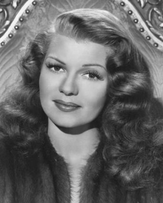 Rita Hayworth-publicity-photo. Original publicity portrait of Rita Hayworth from the film Down to Earth (1947). Columbia Pictures, photograph by Ned Scott. Public domain - Wikipedia.