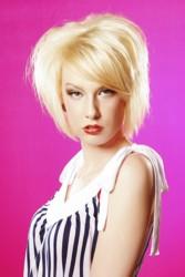 Platinum Blonde Medium Length Layered Hairstyle With SideSwept Fringe Off Side Part