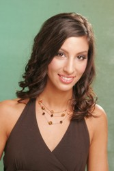 Long Brunette Hairstyle With Curled Edges And Side Swept Fringe Off A Side Swept Part