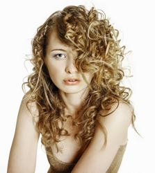 Long Naturally Curly Sandy Blonde Hair With Side Swept Long Fringe