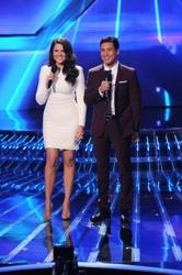 Khloé Kardashian Odom with long waves w/Mario Lopez On X Factor