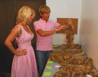 Secrets of clip in hair extensions jessica simpson ken paves examining human synthetic hair pieces at hairdo photo shoot april 2006 pmusecretfo Gallery